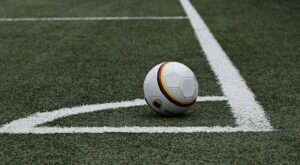 Football on Corner of Pitch Grass White Lines