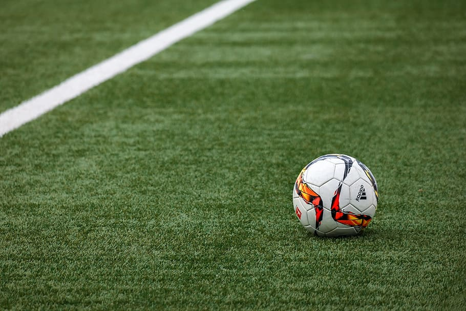 Adidas Football On Pitch Grass